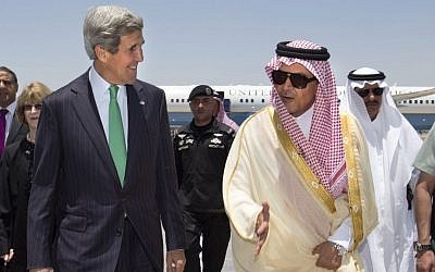 US Secretary of State John Kerry, left, is greeted by Saudi Foreign Minister Prince Saud al-Faisal upon arrival in Jeddah, Saudi Arabia, in June (photo credit: AP/Jacquelyn Martin)