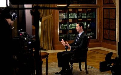 President Bashar Assad gestures as he speaks during an interview with Lebanon's Al-Mayadeen TV, at the presidential palace in Damascus, Syria, Monday, Oct. 21, 2013 (photo credit: AP/SANA)