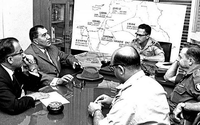 Top Iranian military officials Hasan Toofanian and Bahram Ariana meet with Israeli officers in the headquarters of the Israel Defense Forces, 1975 ((Photo credit: public domain, Wikimedia commons)
