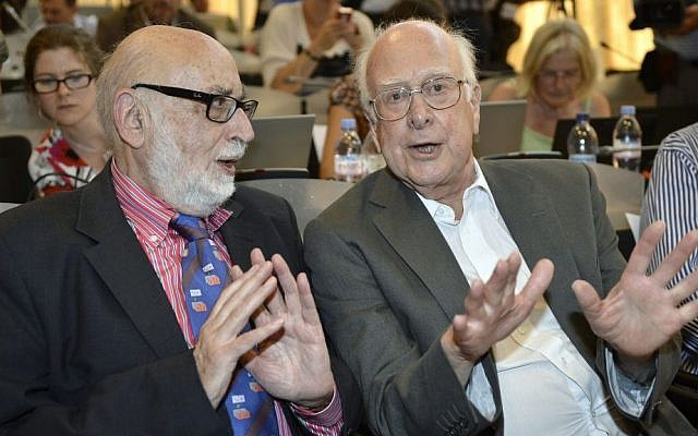 Belgian physicist Francois Englert, left, and British physicist Peter Higgs, right, at the European Organization for Nuclear Research (CERN) in Meyrin near Geneva, Switzerland, on Wednesday, July 4, 2012. (photo credit: AP Photo/Keystone/Martial Trezzini)