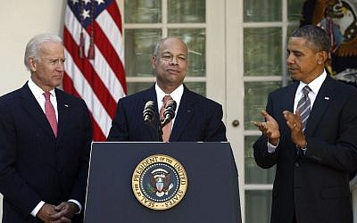 US President Barack Obama, right, stands with Jeh Johnson, center, his choice for the next Homeland Security Secretary, and Vice President Joe Biden in the Rose Garden of the White House, in Washington, Oct. 18 (photo credit: AP/Charles Dharapak)