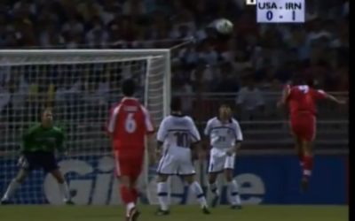 Iran's Hamid Estili (right in red) leaps to head home his country's first goal in Iran's 1998 World Cup soccer victory over the USA in France (screen capture: Youtube)