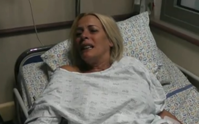Monique Mor, whose husband was killed in a suspected terror attack, speaks to reporters from her hospital bed, October 11, 2013 (photo credit: Walla news screenshot)