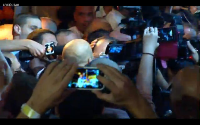 Nir Barkat is swamped by supporters as he arrives to claim victory in the Jerusalem mayoral race, early on October 23, 2013 (photo credit: Walla screenshot)
