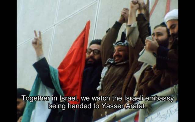 Yasser Arafat at the building that used to house the Israeli embassy (photo credit: screen shot 'Before the Revolution,' courtesy Journeyman Pictures)