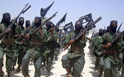 Al-Shabab fighters march with their weapons during military exercises on the outskirts of Mogadishu, Somalia, in 2011. (photo credit: AP/Mohamed Sheikh Nor)