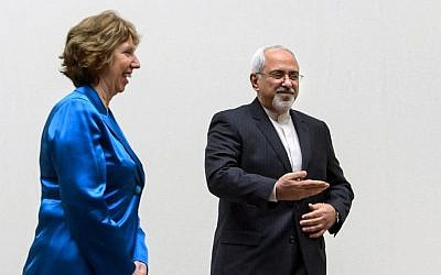 EU High Representative for Foreign Affairs Catherine Ashton, left, walks next to Iranian Foreign Minister Mohammad Javad Zarif during a photo opportunity prior to the start of two days of closed-door nuclear talks on Tuesday, October 15, 2013, at the United Nations offices in Geneva. (photo credit: AP/Fabrice Coffrini, Pool)