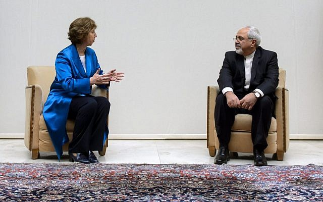 EU High Representative for Foreign Affairs Catherine Ashton, left, talks to Iranian Foreign Minister Mohammad Javad Zarif, right, during a photo opportunity prior to the start of two days of closed-door nuclear talks on Tuesday, October 15, 2013. (photo credit: AP/Fabrice Coffrini, pool)