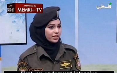 A Palestinian recruit talks of her experience in the parachutists course in Russia (image capture: Youtube)