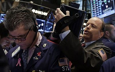 Wall Street traders on Thursday (photo credit: AP/Richard Drew)