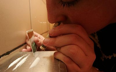 A woman snorts coke in the toilet of a Jerusalem bar. (illustrative photo credit: Michal Fattal/Flash90)