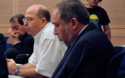 Defense Minister Moshe Ya'alon, in white, addressing the Knesset Foreign Affairs and Defense Committee (Photo credit: Ariel Hermoni/ Ministry of Defense)