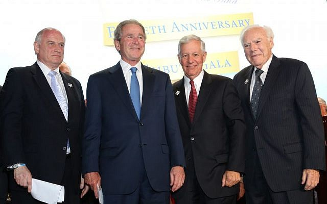 Former President George W. Bush, pictured following his address to the Fiftieth Anniversary Tribute Gala Dinner of the Conference of Presidents of Major American Jewish Organizations. Seen (left to right) are Malcolm Hoenlein, President George Bush, Robert G. Sugarman, and Melvin Salberg. (photo credit: Michael Priest Photography)