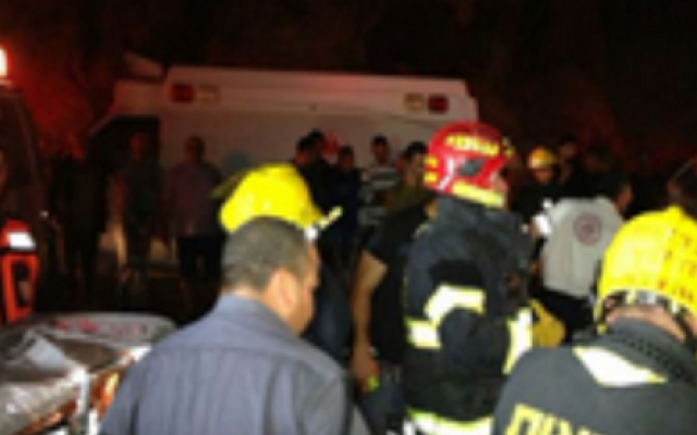 Paramedics and firefighters treat the injured at Lido junction on Wednesday night (photo credit: Hatzolah)