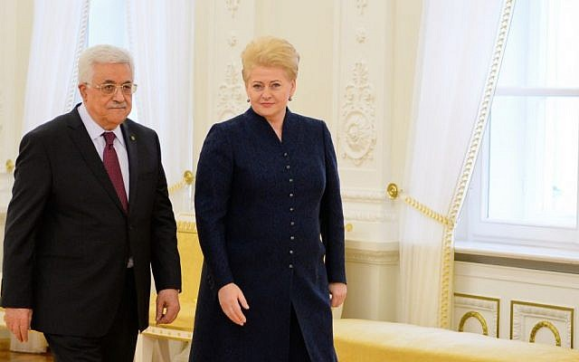 Palestinian Authority President Mahmoud Abbas, left, and Lithuanian President Dalia Grybauskaitė, in Vilnius, Lithuania, on October 21, 2013 (photo credit: courtesy office of the Lithuanian President)