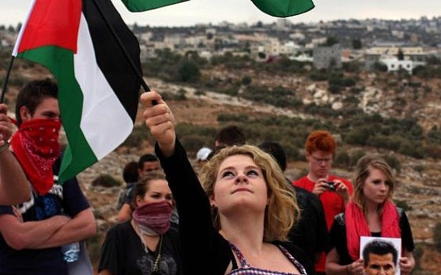 Illustrative photo of Palestinian and foreign activists during a 2010 protest against the security barrier at the West Bank village of Bil'in, near Ramallah (photo credit: Issam Rimawi / Flash90)