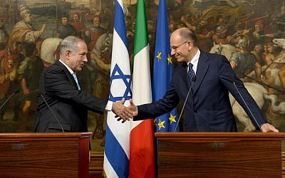 Prime Minister Benjamin Netanyahu shakes hands with his Italian counterpart Enrico Letta, following a meeting in Rome, on Tuesday, October 22, 2013. (photo credit: Avi Ohayon/GPO/Flash90)