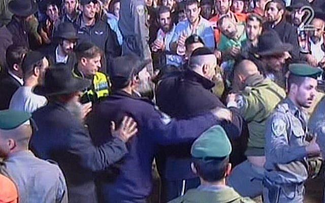 Police and mourners in an altercation at the funeral of Rabbi Ovadia Yosef, in Jerusalem on October 7, 2013. (photo credit: screen capture/Channel 2)