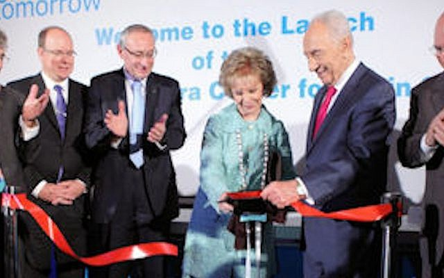 Mrs. Lily Safra cuts the ribbon marking the public launch of the Hebrew University's Edmond and Lily Safra Center for Brain Science as (from right) University Board of Governors Chairman Michael Federmann, President Shimon Peres, University President Prof. Menahem Ben-Sasson, Prince Albert II of Monaco and ELSC Director Prof. Eilon Vaadia look on (Photo credit: Courtesy)