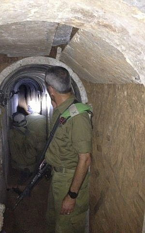 Brig. Gen. Michael Edelstein, Gaza Division commander inside a tunnel dug from the Gaza Strip to Israel, October 13, 2013. (photo credit: Times of Israel/Mitch Ginsburg)
