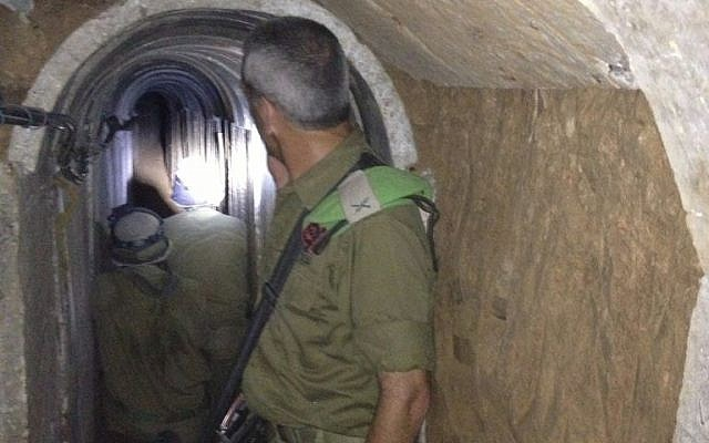 Brig. Gen. Michael Edelstein, Gaza Division commander, inside a terror tunnel that leads from the Gaza Strip to Israel, in November 2013 (photo credit: Times of Israel/Mitch Ginsburg/File)