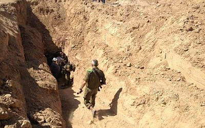Brig. Gen. Michael Edelstein, commander of the Gaza division, entering an offensive tunnel that was discovered in October 2013. (Mitch Ginsburg/ Times of Israel staff)