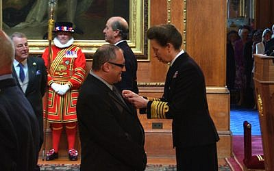 Prof. David Newman receives the OBE from Princess Anne. (photo credit: courtesy)