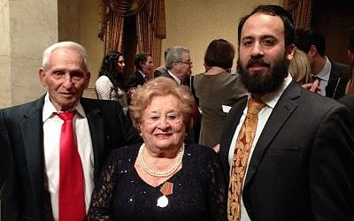 Illustrative: Aron Bell, the last surviving Bielski brother, with fellow partisan Leah Johnson and her grandson Rabbi Zev Johnson at a Jewish Partisan Educational Foundation tribute dinner in New York City. (photo credit: Renee Ghert-Zand)