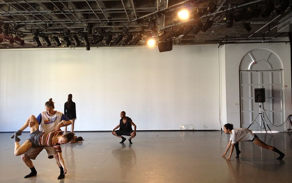 Members of Batsheva Dance Company's senior ensemble performing part of 'Sadeh21' in a preview of the 2014 season. (photo credit: Jessica Steinberg/Times of Israel)