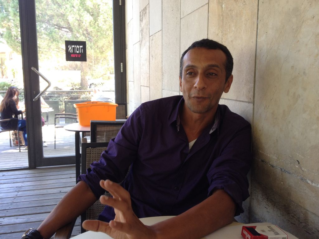 Haitham Omari has been a cameraman for much of his professional life (photo credit: Jessica Steinberg/Times of Israel)