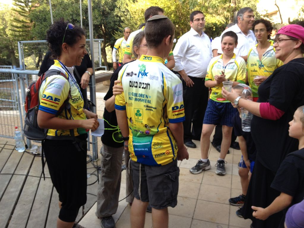 Ruth Vitztum congratulating one of her riders (photo credit: Jessica Steinberg/Times of Israel)