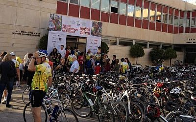 Cyclists riding in, getting medals, snacks and drinks before the end-of-ride celebration at Alyn Hospital.(photo credit: Jessica Steinberg/Times of Israel)