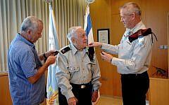 Lt. Gen. Benny Gantz (right), slipping the general's rank on Pundak's left shoulder. (photo credit: IDF Spokesperson's blog)