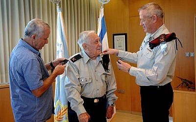 Lt. Gen. Benny Gantz (right), slipping the general's rank on Pundak's left shoulder. (photo credit: IDF Spokesperson's blog)