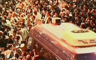 A van carrying Rabbi Ovadia Yosef's body slowly moves through the crowd (photo credit: screen capture/Channel 2)