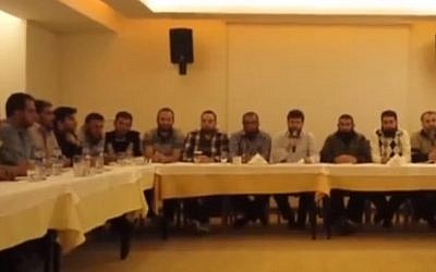 Screenshot from a video released Sunday, October 27, 2013 by 19 Syrian rebel groups stating their rejection of  peace talks planned in Geneva for November 23-24.