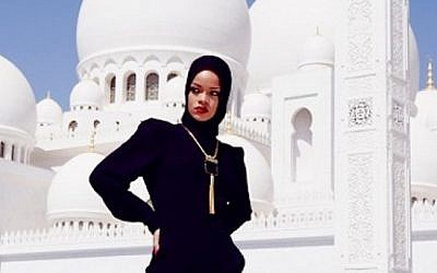 Rihanna poses outside a mosque in Abu Dhabi (photo credit: Instagram)