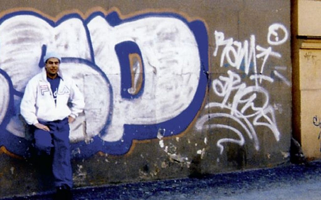 Arye Sharuz Shalicar, a well known graffiti artist, in front of some of his old work (Photo credit: courtesy Arye Shalicar)