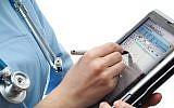 A nurse uses a digital health app (Courtesy)