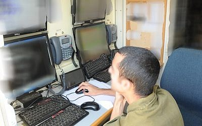 A member of the Lotem unit monitors field activity at Lotem headquarters. (photo: IDF Spokesperson)