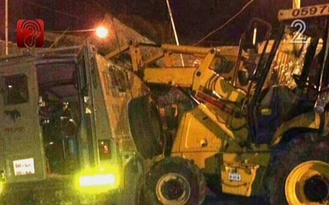 A small tractor shown after it was used in assault attempt at an IDF base, on October 17, 2013 (photo credit: screen capture Channel 2)