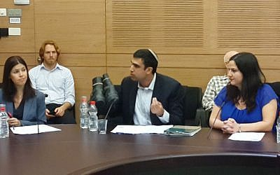 MK Yoni Chetboun making a point with his old boots (Photo credit: Courtesy Yoni Chetboun)