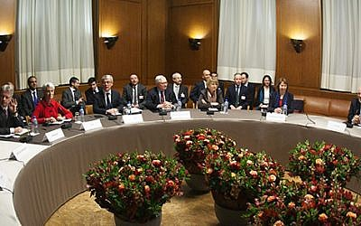 Negotiators from Iran and six world powers meeting in Geneva on November 22, 2013. (photo credit: US State Department)