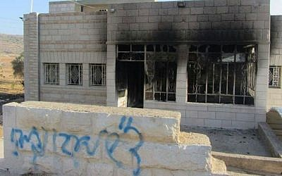 A house in the West Bank village of Sinjil that was set fire overnight Wednesday, November 14, 2013 (photo credit: courtesy B'Tselem)