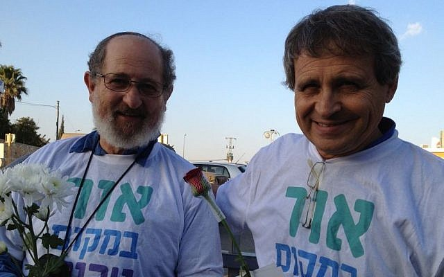 Gadi Gvaryahu (right) and Rabbi Yehiel Grenimann of Rabbis for Human Rights stand outside the Rami Levi supermarket as part of the Tag Meir activities (photo credit: Elhanan Miller/Times of Israel)