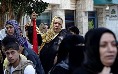 Palestinian supporters of the Democratic Front for the Liberation of Palestine, chant slogans against US Secretary of State John Kerry's visit to Jerusalem and Bethlehem, during a protest in Gaza City, Wednesday, November 6, 2013. (photo credit: AP/Adel Hana)