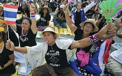 Anti-government protesters stage a sit-in at the Finance Ministry in Bangkok, Thailand, Tuesday, Nov. 26, 2013. (photo credit: AP Photo/Sakchai Lalit)