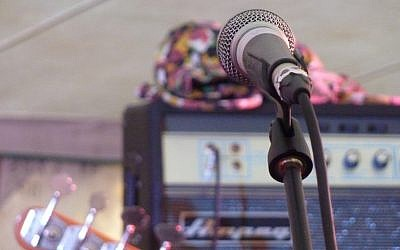 Illustration: A singer's microphone and amplifier. (photo credit: CC BY 2.0 Flickr/Magnus D)