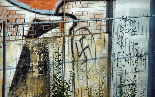 Illustrative photo of graffiti featuring a swastika. (CC BY-HHA124L/Flickr/File)