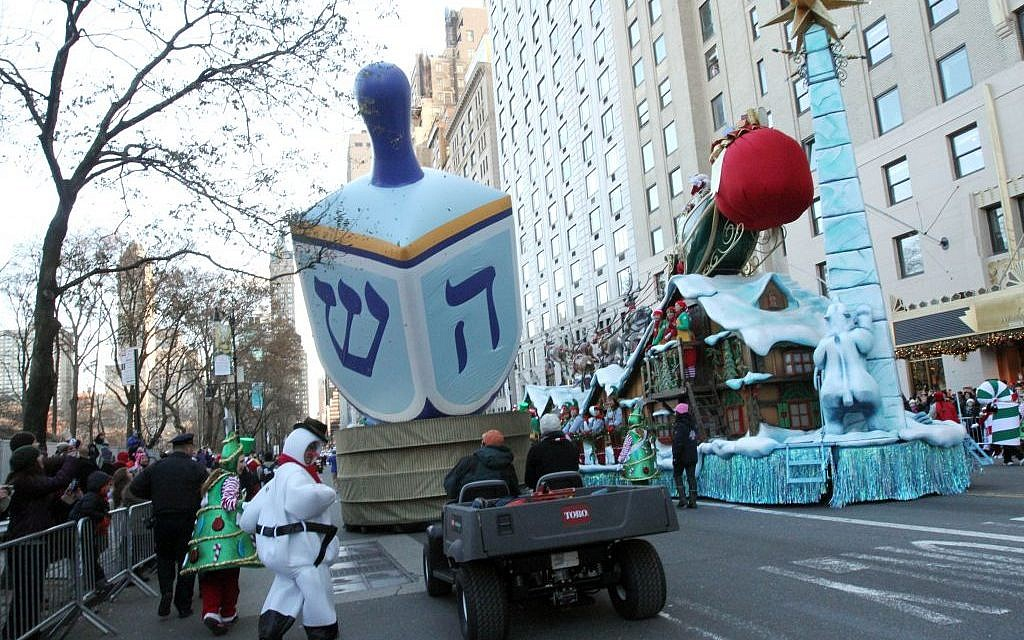 Illustrative: A dreidel balloon is paraded down Central Park South as part of the Macy's Thanksgiving Day Parade, November 28, 2013. (AP/Tina Fineberg)